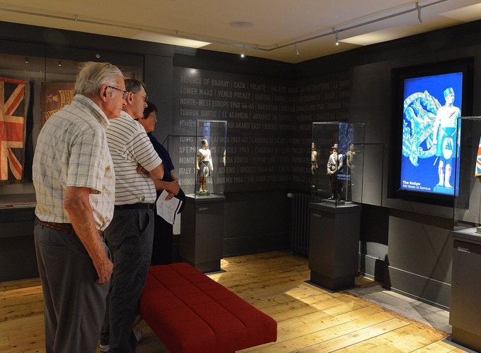 Group of visitors touring the history galleries of the Black Watch Museum