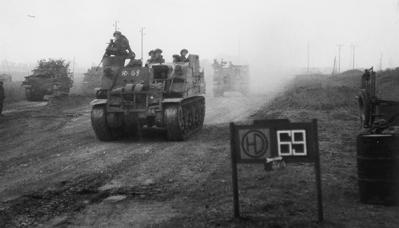 Men of the Black Watch 7th Battalion move forward to cross the Rhine in March 1945 where they were to be the first to reach the far bank.