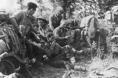 6 pounder anti tank detachment of the Black Watch 6th Battalion relax near Monte Cassino in May 1944.