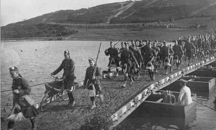Black and white photograph of Black Watch battalion marching