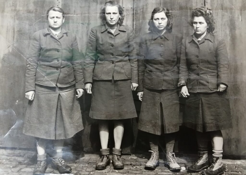 Black and white photgraph of 4 woment on trial at the Belson trials