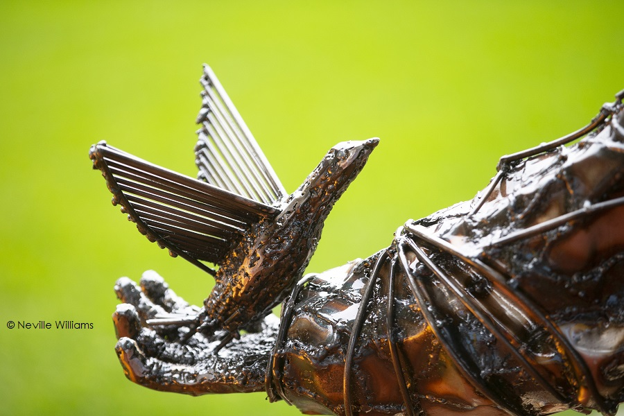 close up of steel dove, part of a larger sculpture of a soldier