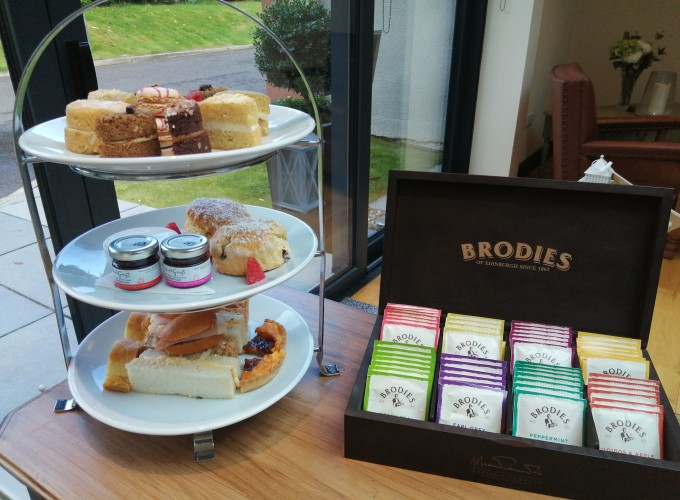 Afternoon tea on 3 tiered cake stand with a selection of speciality teas