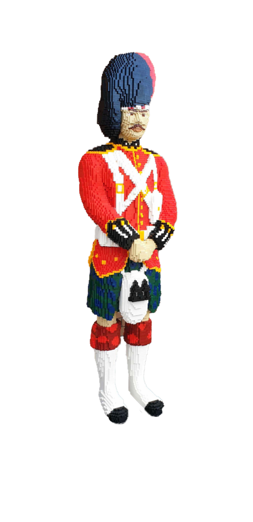life sized model of a black watch guardsman made from small toy bricks