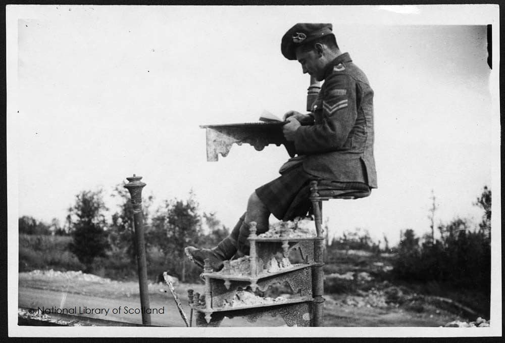 Solider reading book during WW1. Image from National Library of Scotland