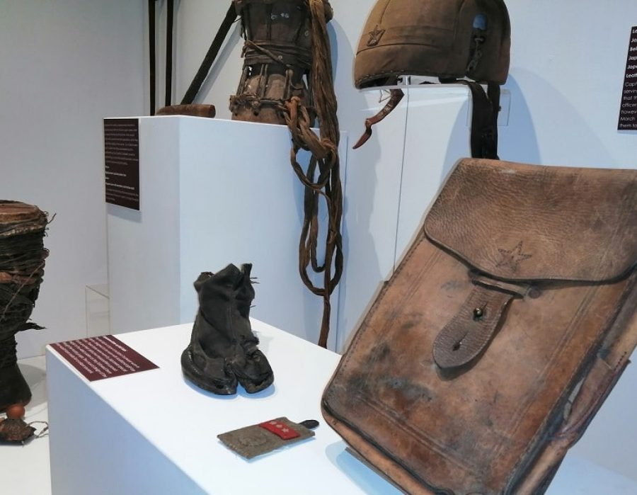 museum exhibition showing artfects that soldiers have brought home from war