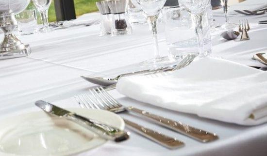 table setting on crisp white linen