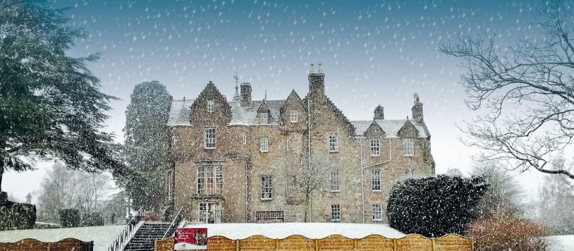 Balhousie Castle in Perth in the Winter time with snow falling