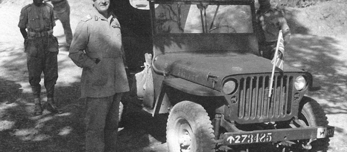 Black And white photograph of Earl Wavell next to a jeep